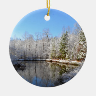 Snow covered landscape around the pond round ceramic ornament