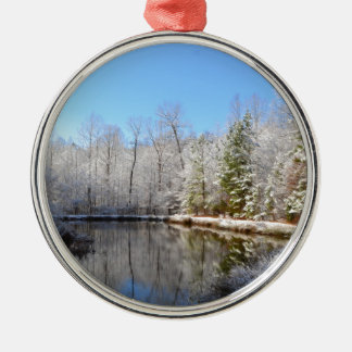 Snow covered landscape around the pond Silver-Colored round ornament