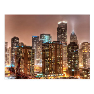 Snow falls over skyline at evening in Chicago Postcard