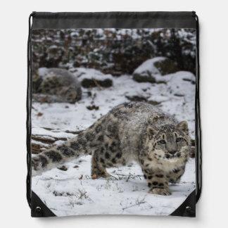 Snow Leopard Cub Stalking Birds Drawstring Backpack