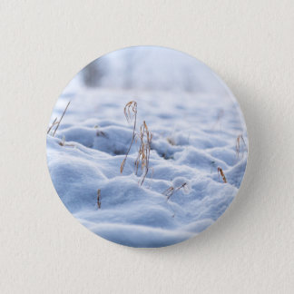 Snow on a meadow in winter macro 2 inch round button