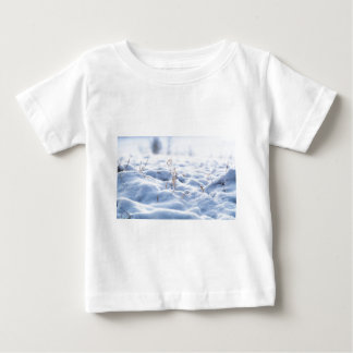Snow on a meadow in winter macro baby T-Shirt
