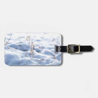 Snow on a meadow in winter macro luggage tag