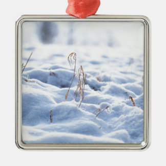 Snow on a meadow in winter macro metal ornament