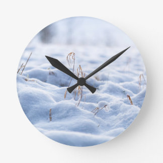 Snow on a meadow in winter macro round clock