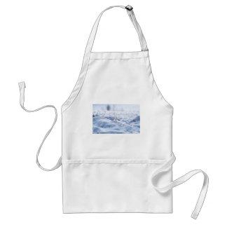 Snow on a meadow in winter macro standard apron