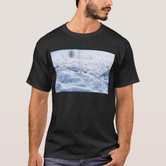 Snow on a meadow in winter macro T-Shirt