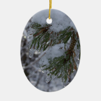 Snow on pine tree ceramic ornament