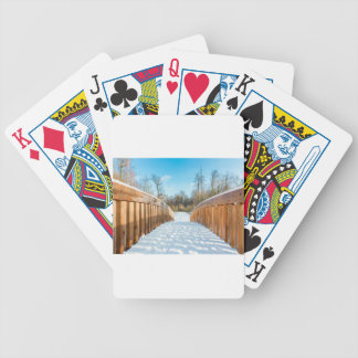 Snow on wooden bridge in forest bicycle playing cards