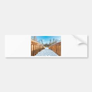 Snow on wooden bridge in forest bumper sticker
