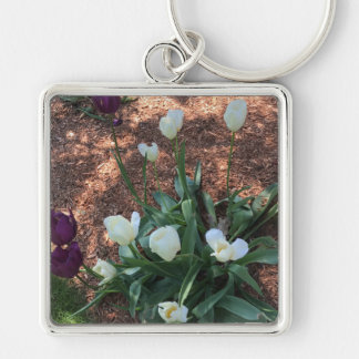 Snow white tulip type flowers in a garden keychain