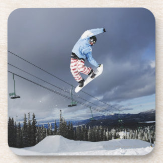 Snowboarder jumping in mid-air doing a backside beverage coasters