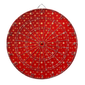 Snowflakes on red dartboard with darts
