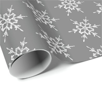 Snowflakes, silver crystals on charcoal grey wrapping paper