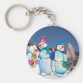 Snowman band singing on the hillside key chain