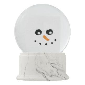 Snowman face snow globe