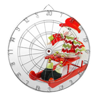 Snowman figurine sitting on red sledge dartboard with darts
