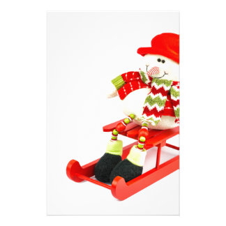 Snowman figurine sitting on red sledge personalized stationery