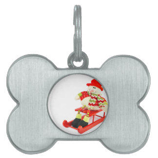 Snowman figurine sitting on red sledge pet name tag