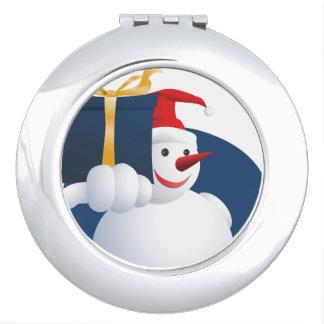 Snowman hands over gift... makeup mirror