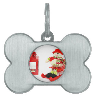 Snowman on sleigh with red lantern pet ID tag