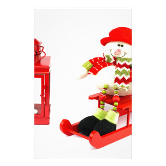 Snowman on sleigh with red lantern stationery paper