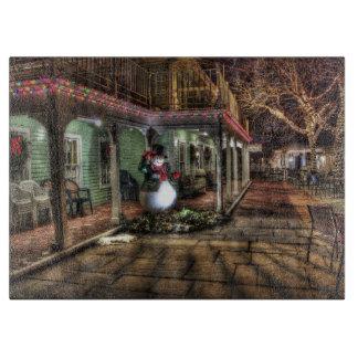 Snowman on the Porch in Winter Wonder Land Cutting Board