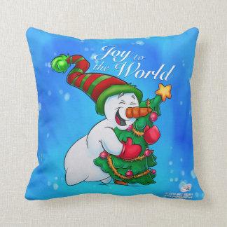 Snowman pillow hugging a Christmas tree