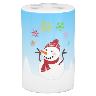 Snowman playing in the snow soap dispenser and toothbrush holder