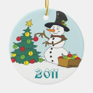 Snowman Trimming Tree Round Ceramic Ornament