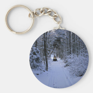 Snowmobiling after fresh snowfall Winter Basic Round Button Keychain