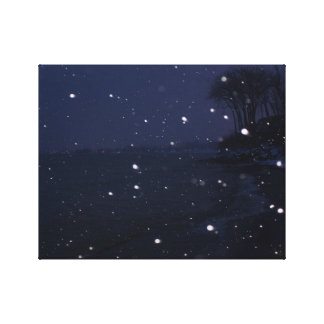 Snowy beach scene at dusk canvas print