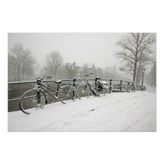 Snowy bikes in Amsterdam the Netherlands Poster
