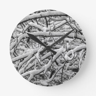 Snowy branches round clock