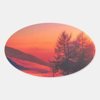 Snowy Evening Sunset Oval Sticker