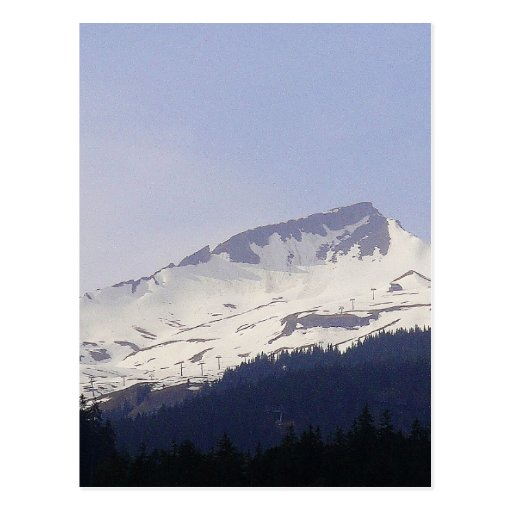 Snowy mountain before blue sky postcards