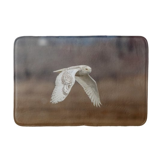 Snowy owl in flight bath mat