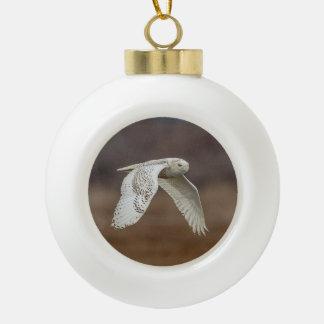 Snowy owl in flight ceramic ball christmas ornament