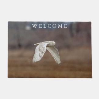 Snowy owl in flight doormat