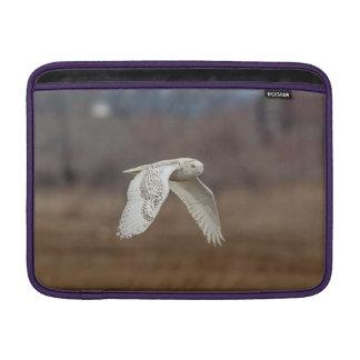 Snowy owl in flight MacBook sleeve