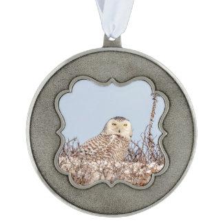 Snowy owl sitting on the beach ornament