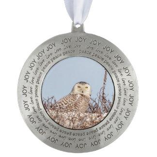 Snowy owl sitting on the beach pewter ornament