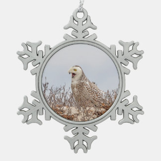 Snowy owl sitting on the beach snowflake pewter christmas ornament