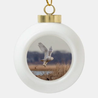 Snowy owl taking off ceramic ball christmas ornament