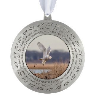 Snowy owl taking off pewter ornament