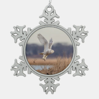 Snowy owl taking off snowflake pewter christmas ornament