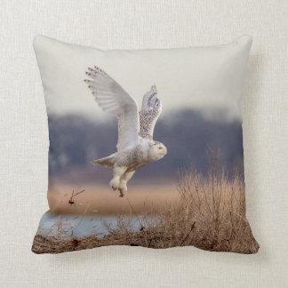 Snowy owl taking off throw pillow