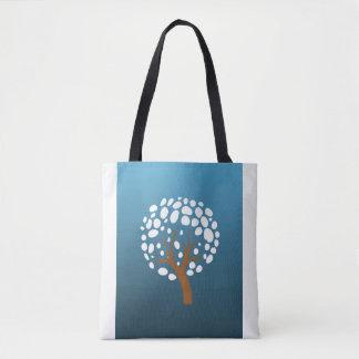 Snowy stylized tree tote bag