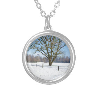 Snowy winter landscape with bare tree and blue sky silver plated necklace