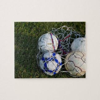 Soccer balls in net jigsaw puzzle